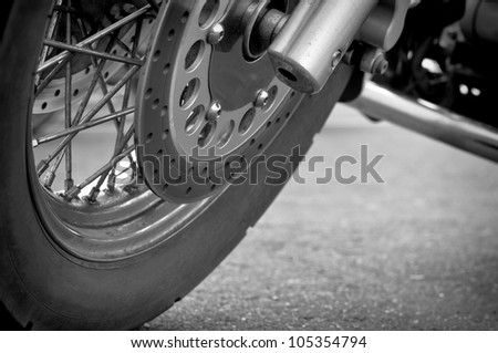 Wheel motorcycle close up, black and white photography. Llow point shooting.