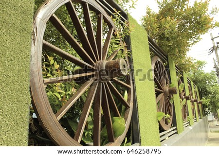 Wheel of cart to decorate the fence #646258795