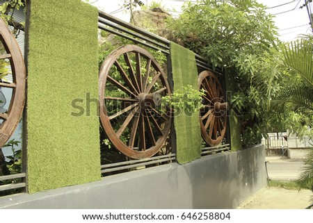 Wheel of cart to decorate the fence #646258804