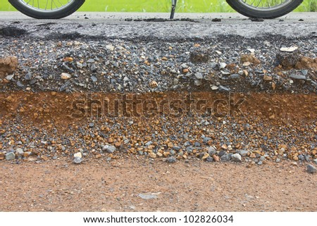 Wheel of the motorcycle sits on Section of asphalt road in rural areas. #102826034