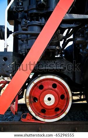Wheel of vintage steam locomotive and drag