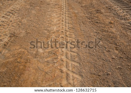 wheel tracks on dirt