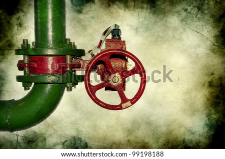 Wheel valve with pipe on grunge background