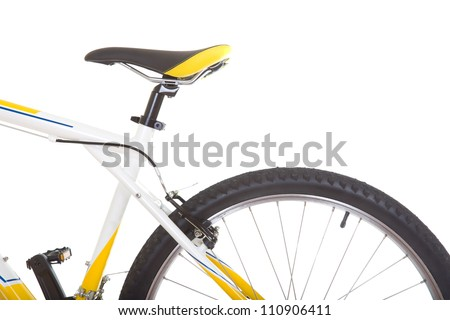 ... tire and saddle of mountain bike close up isolated on white background