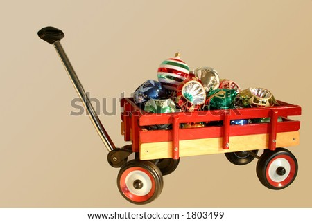 wheelbarrow full of christmas balls - stock photo