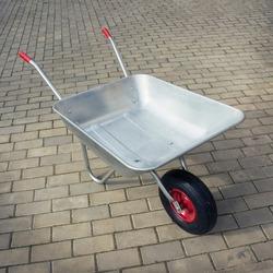Wheelbarrow on stone floor. Garden one-wheeled metal cart