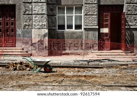 Wheelbarrow on the construction site of the street