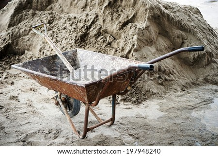 wheelbarrow to work area at a building site