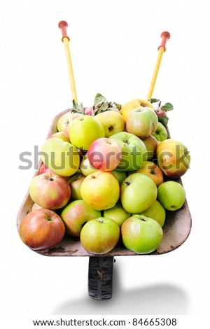 Wheelbarrow with apples isolated on white - stock photo