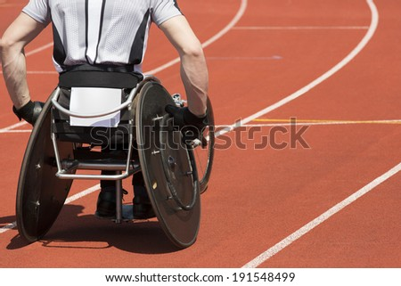 Wheelchair athlete concentrates  for his race to start.