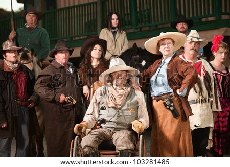 Wheelchair bound cowboy with wife and old west era gang