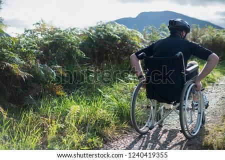 Wheelchair bound man in the wilderness