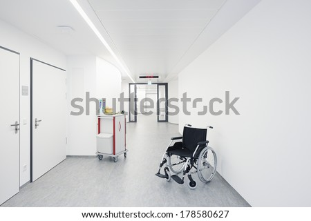 Wheelchair in the hallway with a door at the hospital