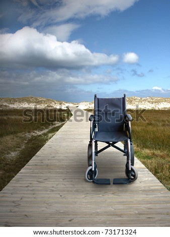 Wheelchair on a track to the beach