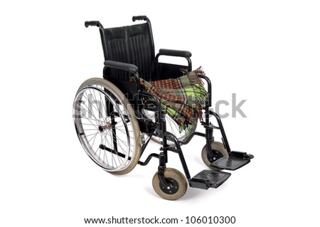 Wheelchair with blanket isolated in white background - stock photo