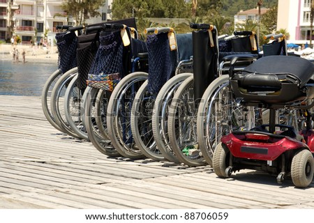 Wheelchairs at harbor waiting for passengers