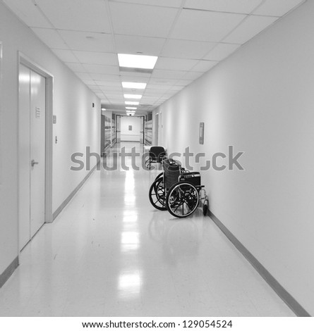 Wheelchairs in a White Hospital Hallway