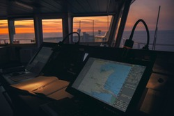 wheelhouse in modern ship with ECDIS and Bridge Log book