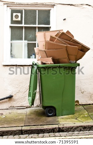 Wheely bin full of cardboard