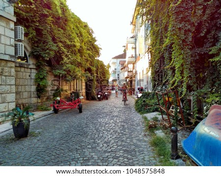When a typical street in a small coastal town in Montenegro with a long tradition #1048575848
