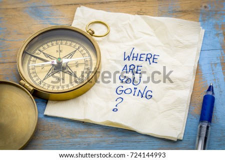 Where  are you going? -An essential question or searching for purpose  - a napkin doodle with a brass compass Stockfoto ©