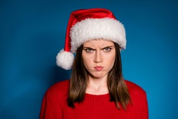 Where chirstmas party gift present close up portrait sullen anger girl grimace have bad mood newyear event wear season winter outfit santa claus hat isolated gradient blue color background