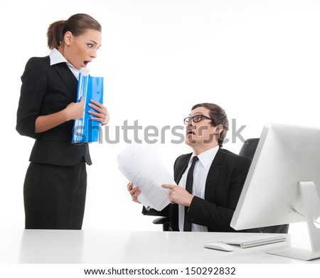 Where is the report? Stressed young businessman shouting at his secretary while sitting at his working place