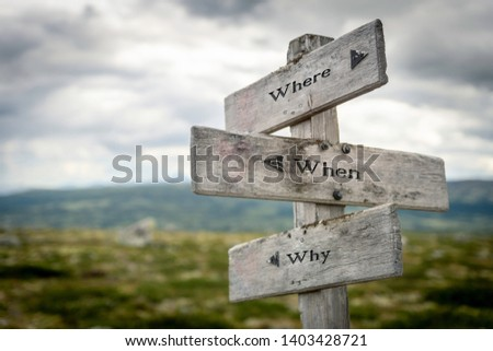 Where, when and why text on wooden sign/road post outdoors in nature. Who, question, quote, find out, business concept. #1403428721