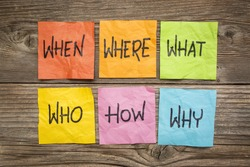 where, when, who, what, why, how questions - uncertainty, brainstorming or decision making concept, colorful crumpled sticky notes on grained wood