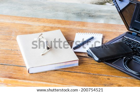 Wherever working table with laptop and stationary, stock photo