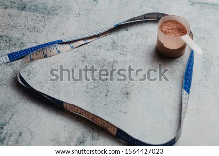 Whey protein scoop and measure tape with copy space