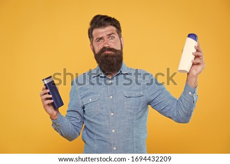 Which shampoo is better for beard. Bearded man choose shampoo for beard hair. Beard products. Care of beard and moustache. Maintaining facial hair. Grooming habits.