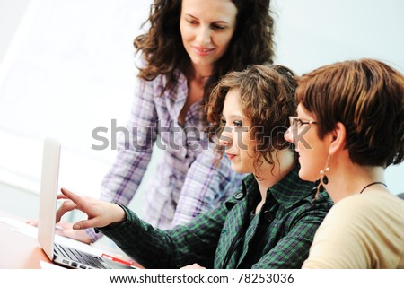 While  meeting, group of young women working together on the table