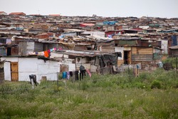 While segregation is no longer the law, many black South Africans live in shantytown townships made of corrugated metal and cardboard.