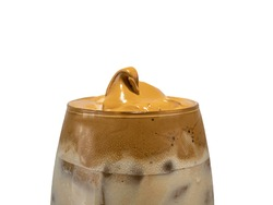 Whipped coffee or Korean style Dalgona Coffee in a clear glass close up photograph