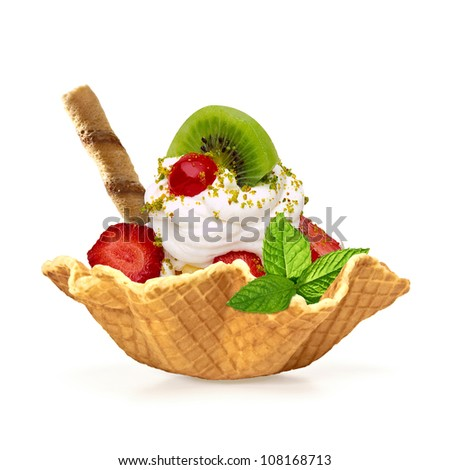 Whipped cream with fruits in wafer bowl - stock photo