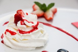Whipping Cream with strawberry sauce