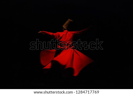 Whirling Dervish with red costume on black background Stock photo ©