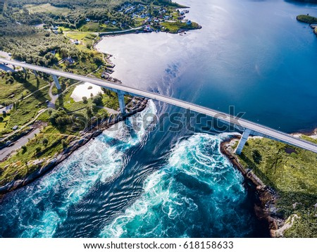Photo of  Whirlpools of the maelstrom of Saltstraumen, Nordland, Norway aerial view Beautiful Nature. Saltstraumen is a small strait with one of the strongest tidal currents in the world.