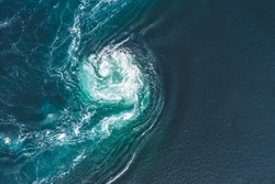 Whirlpools of the maelstrom of Saltstraumen, Nordland, Norway. Saltstraumen is a small strait with one of the strongest tidal currents in the world. By Letowa.