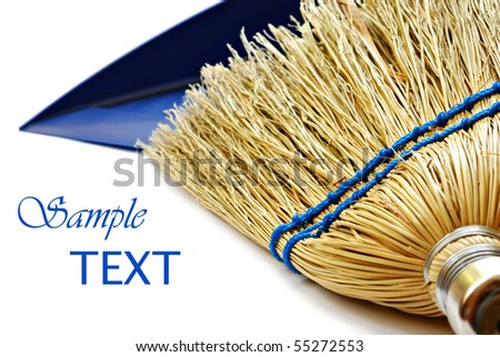 Whisk broom and dustpan on white background with copy space.  Macro with shallow dof.