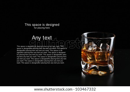 whiskey and ice cube isolated on black background