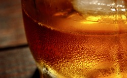 Whiskey and ice Macro Background.Food and drinks macro texture concept