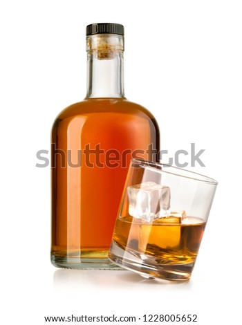 whiskey bottle with glass isolated on white background #1228005652