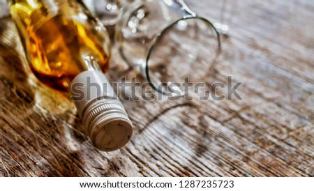 Whiskey, brandy, brandy. Luxury alcohol in a bottle and glasses on a stone background. Valentine's Day, Date #1287235723