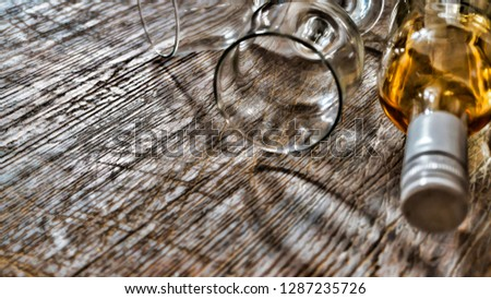 Whiskey, brandy, brandy. Luxury alcohol in a bottle and glasses on a stone background. Valentine's Day, Date #1287235726