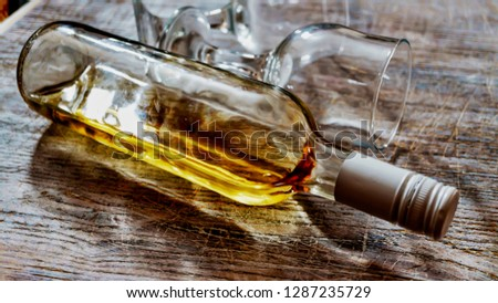 Whiskey, brandy, brandy. Luxury alcohol in a bottle and glasses on a stone background. Valentine's Day, Date #1287235729