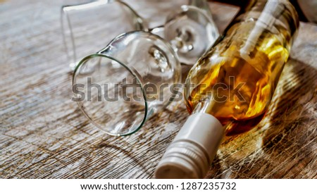Whiskey, brandy, brandy. Luxury alcohol in a bottle and glasses on a stone background. Valentine's Day, Date #1287235732