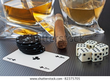 Whiskey, cigar, dice and cards over black background - stock photo