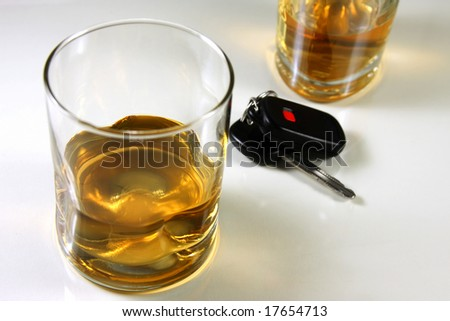 Whiskey drink with car keys, drunk driving and prevention.